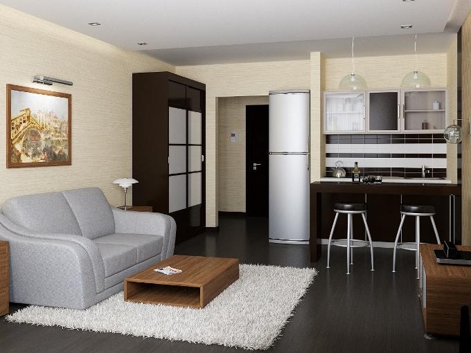При совмещении кухни и гостиной нужно учесть проблему запахов.