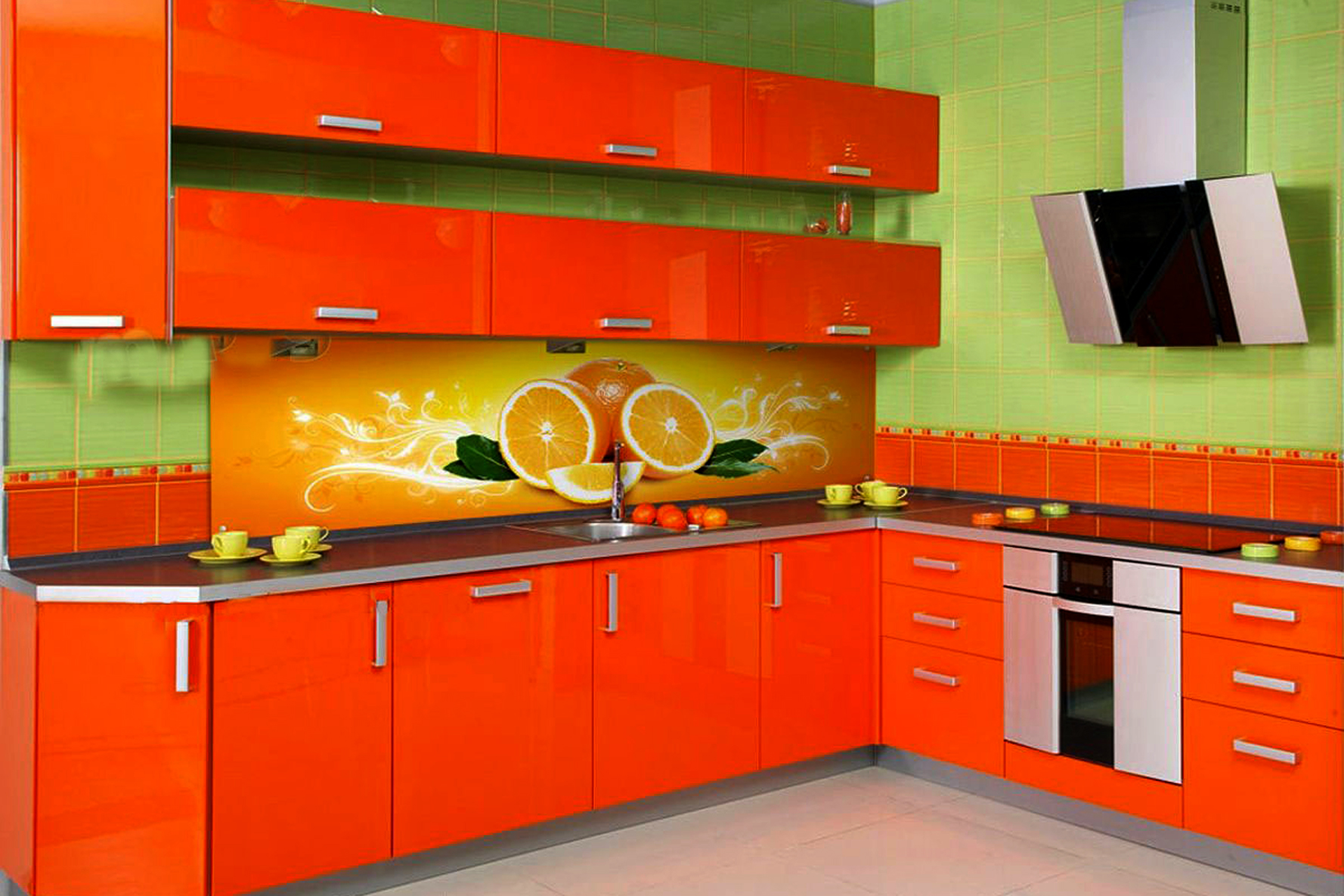 Интерьер зелено–оранжевой кухни