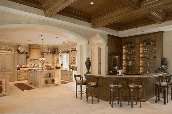 Кухня-гостиная с барной стойкой и цветовым зонированием