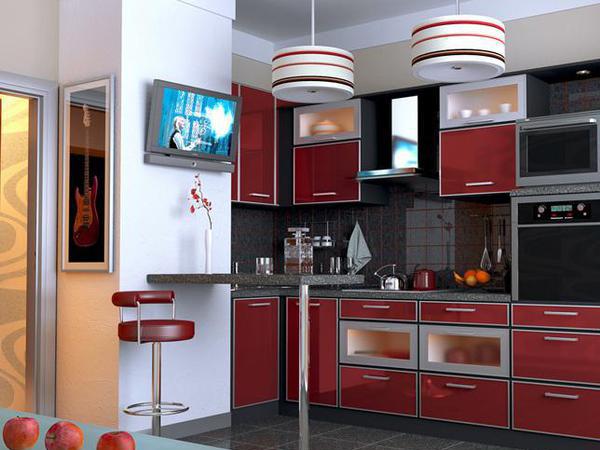 Телевизор, размещённый на венткоробе кухни