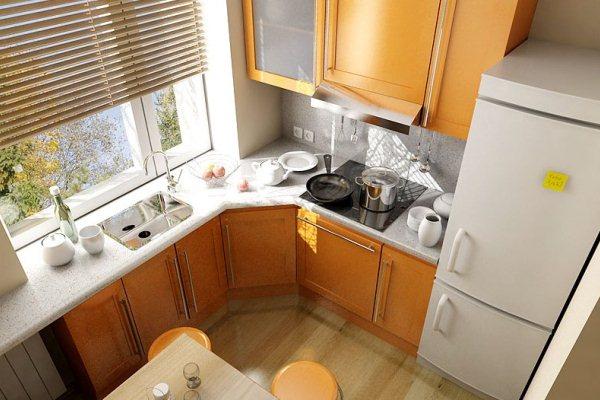 Подоконник-столешница с мойкой в маленькой кухне