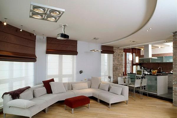 Напольное покрытие отлично зонирует кухню и гостинную